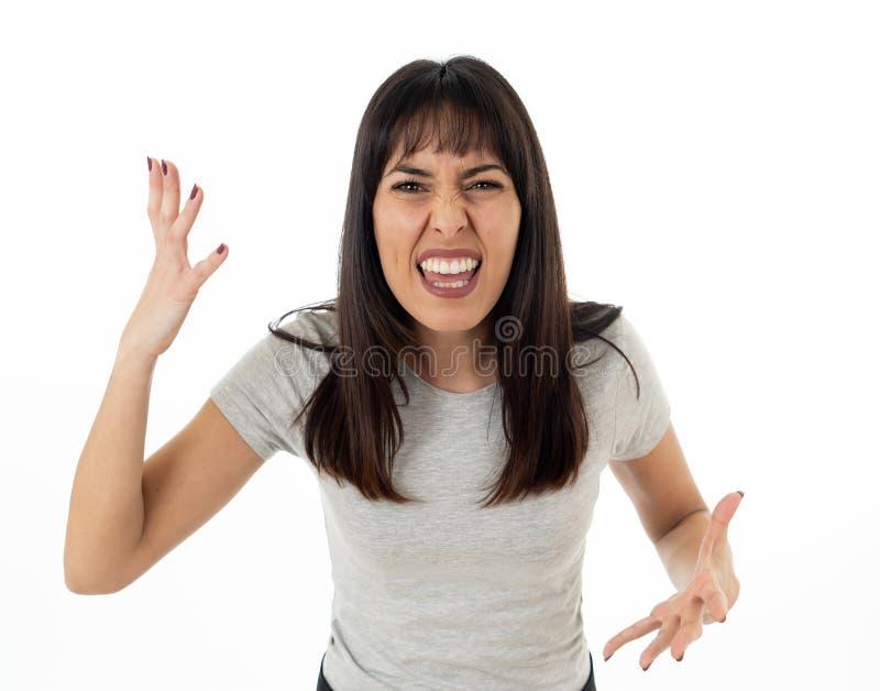 Mulher atrativa nova desesperada com a cara irritada que olha furioso Expressões e emoções humanas imagem de stock royalty free