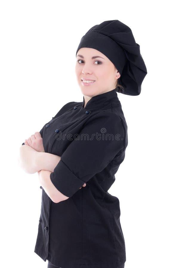 Mulher atrativa nova do cozinheiro no uniforme preto isolado no branco foto de stock royalty free