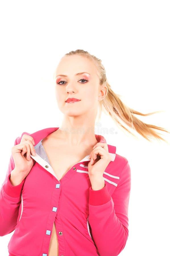 Mulher atrativa nova na cor-de-rosa foto de stock royalty free