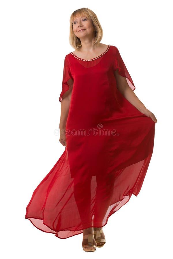 Mulher atrativa que acena o vestido vermelho excelente fotografia de stock
