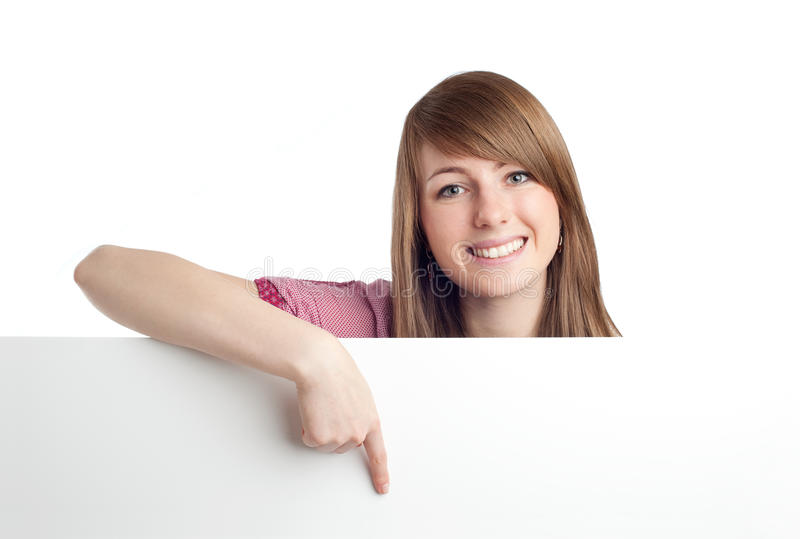 Mulher Atrativa Que Aponta O Sinal Em Branco. Sorriso. Imagens de Stock
