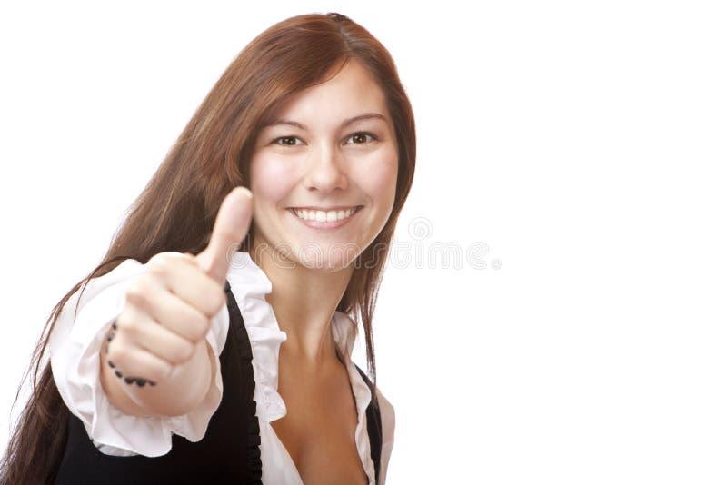 A mulher bávara nova no Dirndl mostra o polegar acima fotografia de stock royalty free