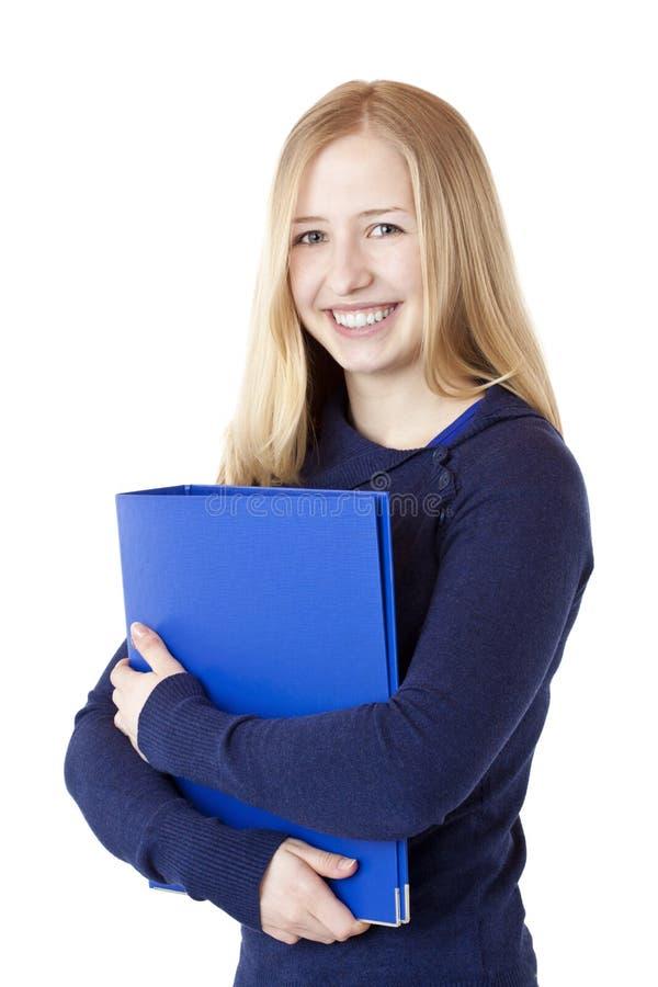 A mulher bem sucedida nova com dobrador sorri feliz imagem de stock royalty free