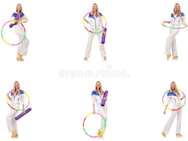 Mulher bonita com a aro do hula isolada no branco fotos de stock royalty free