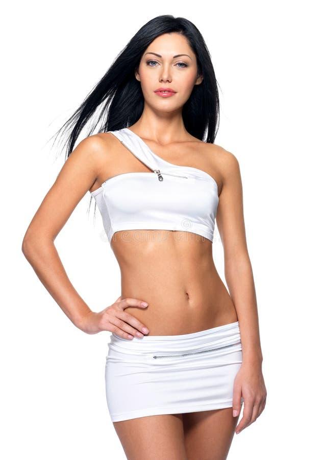 Mulher bonita com corpo magro desportivo fotos de stock