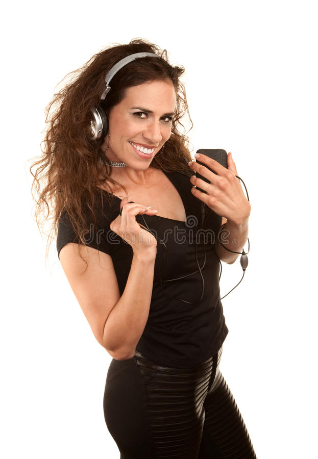 Mulher bonita com dispositivo audio handheld fotografia de stock