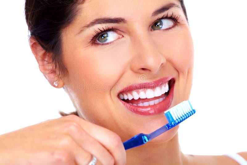 Mulher bonita com escova de dentes. imagem de stock royalty free