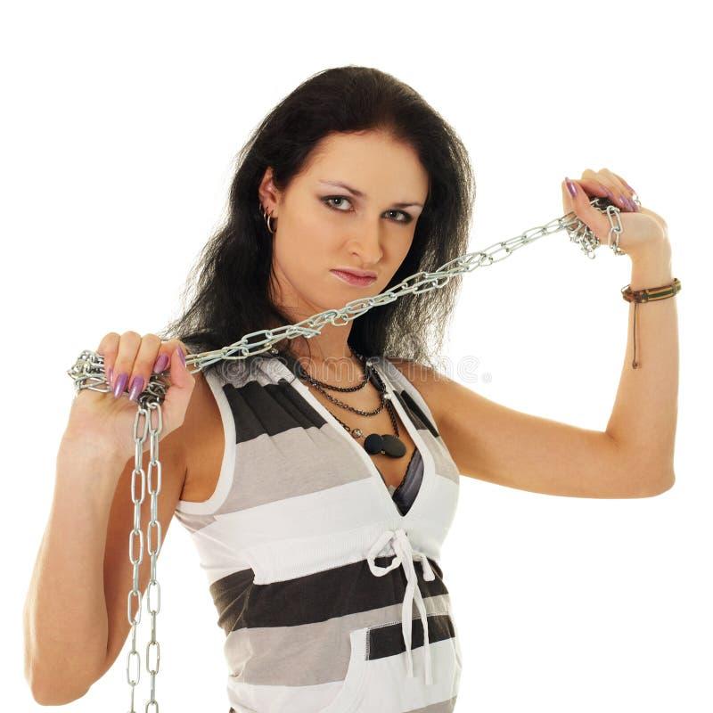 Mulher bonita com grilhões de aço foto de stock