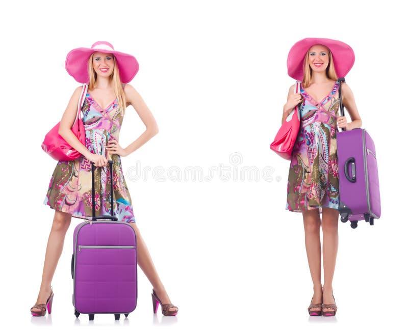 A mulher bonita com a mala de viagem isolada no branco fotos de stock royalty free