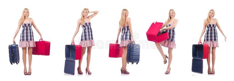 A mulher bonita com a mala de viagem isolada no branco imagem de stock