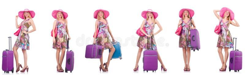 A mulher bonita com a mala de viagem isolada no branco foto de stock royalty free