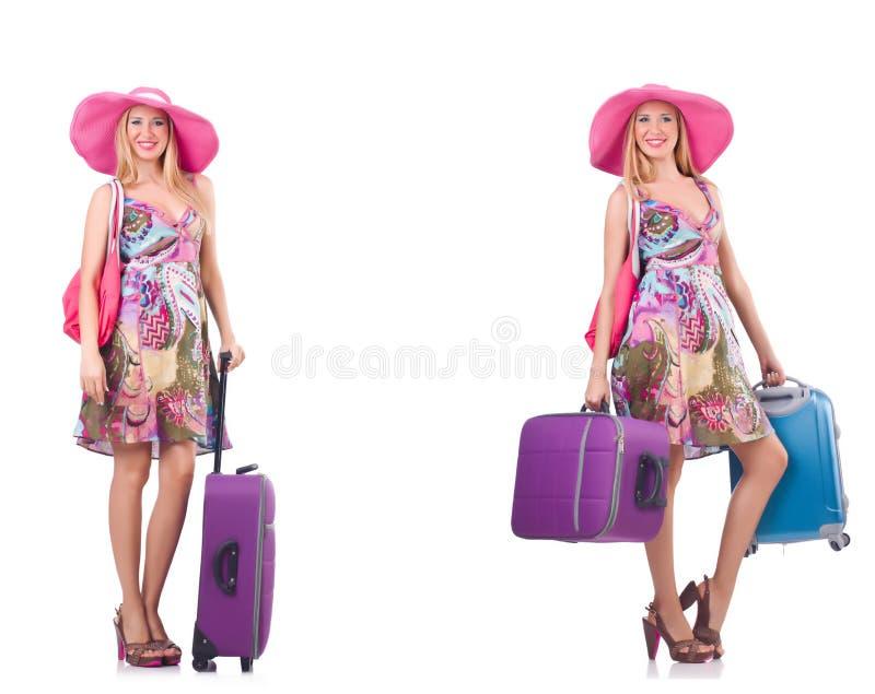 A mulher bonita com a mala de viagem isolada no branco fotografia de stock