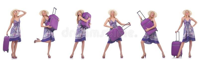 A mulher bonita com a mala de viagem isolada no branco foto de stock