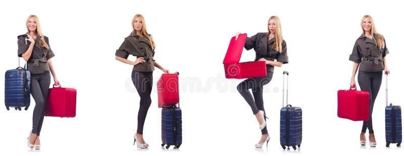 A mulher bonita com a mala de viagem no conceito das f?rias fotografia de stock royalty free