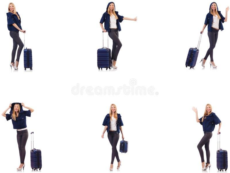 A mulher bonita com a mala de viagem no conceito das f?rias imagem de stock royalty free