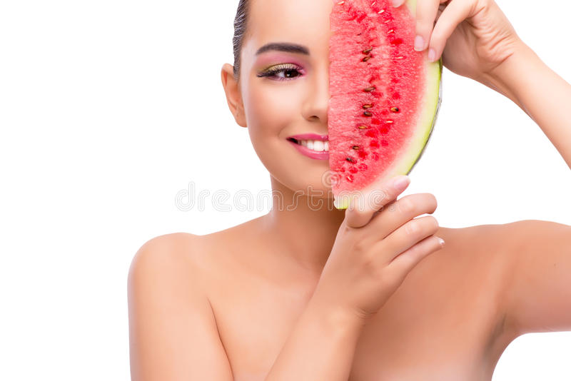 A mulher bonita com a melancia isolada no branco foto de stock