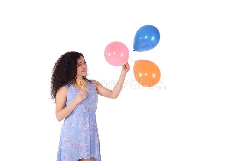 Mulher bonita com pirulito e baloons doces foto de stock
