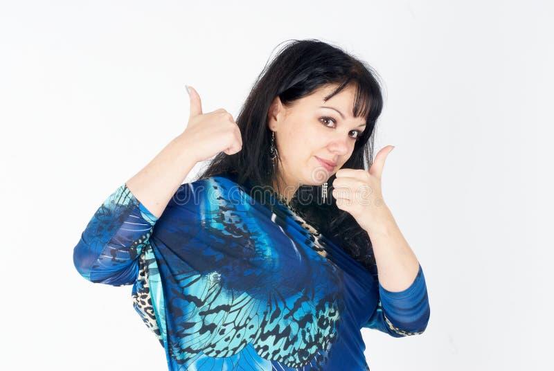 Mulher bonita com polegares acima imagem de stock