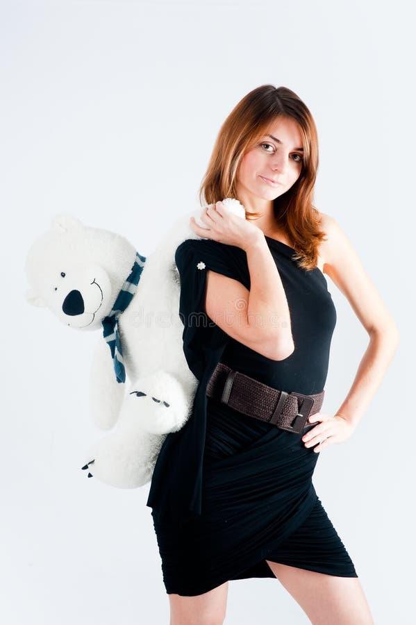Mulher bonita com urso branco imagem de stock royalty free