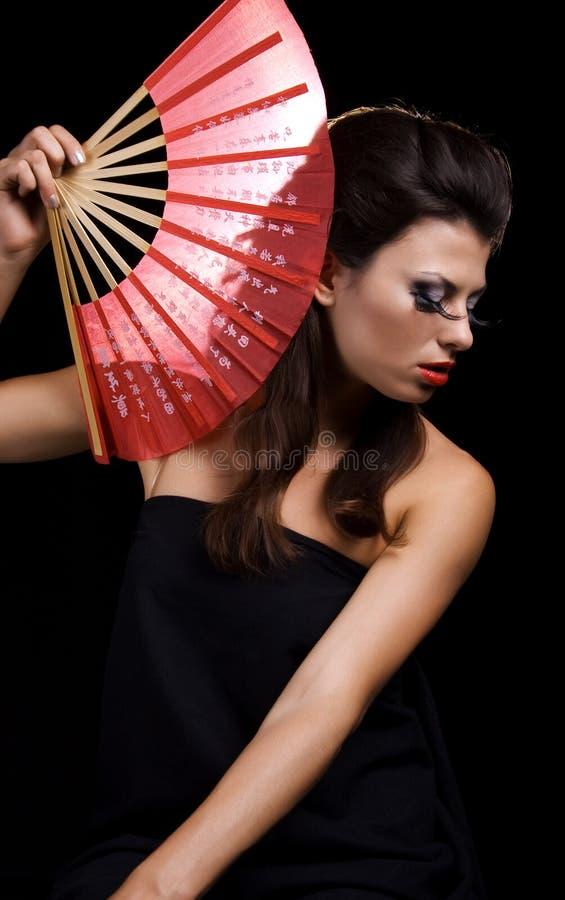 Mulher bonita com ventilador imagens de stock