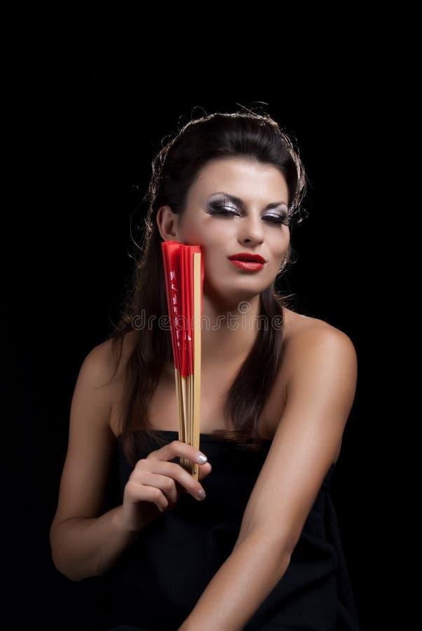 Mulher bonita com ventilador foto de stock