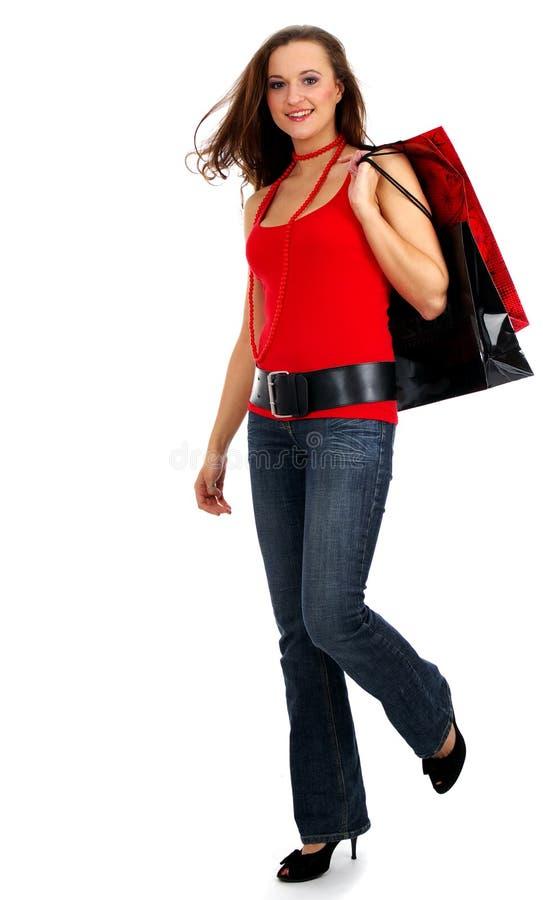Mulher bonita de compra de compra da mulher bonita sobre w imagem de stock royalty free