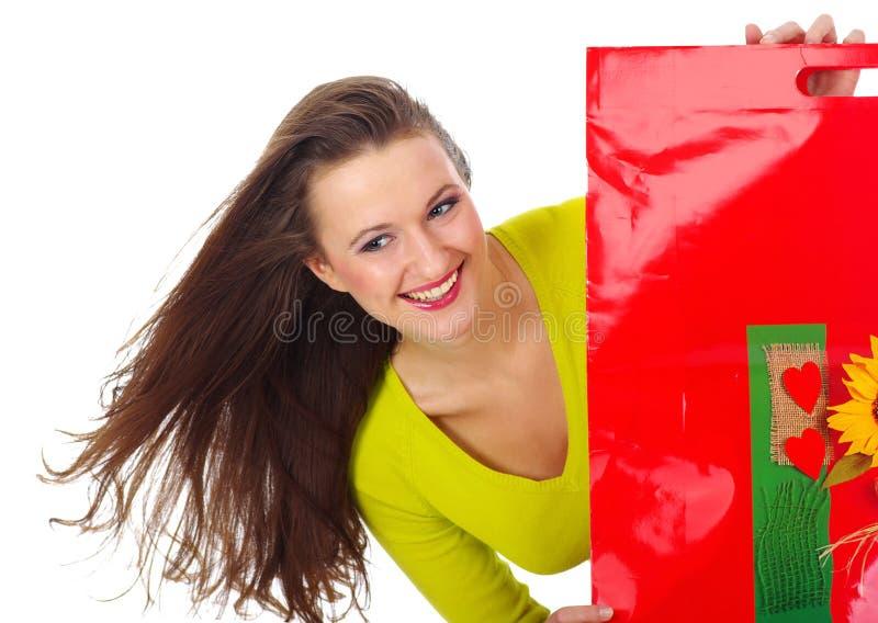 Mulher bonita de compra sobre o fundo fotos de stock