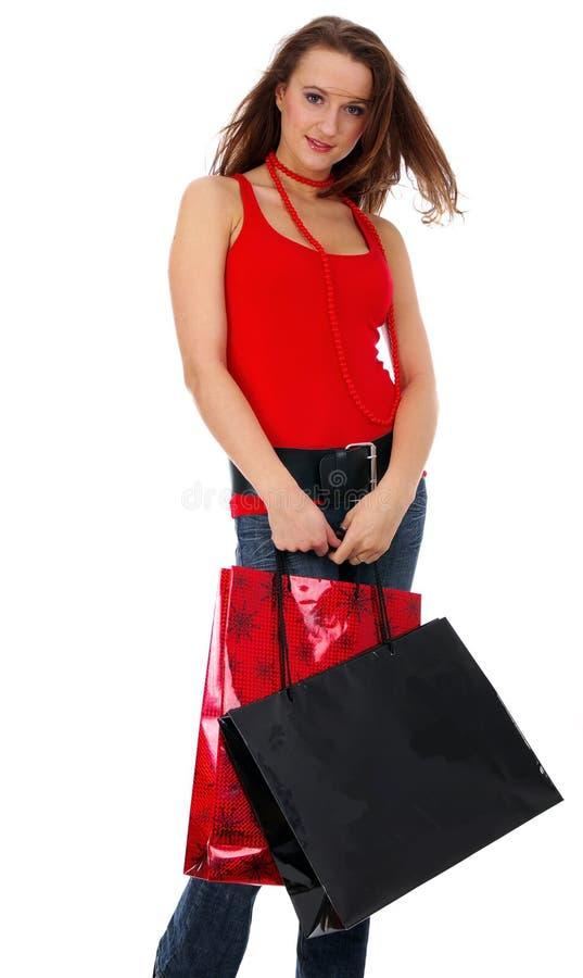 Mulher bonita de compra sobre o fundo branco fotografia de stock