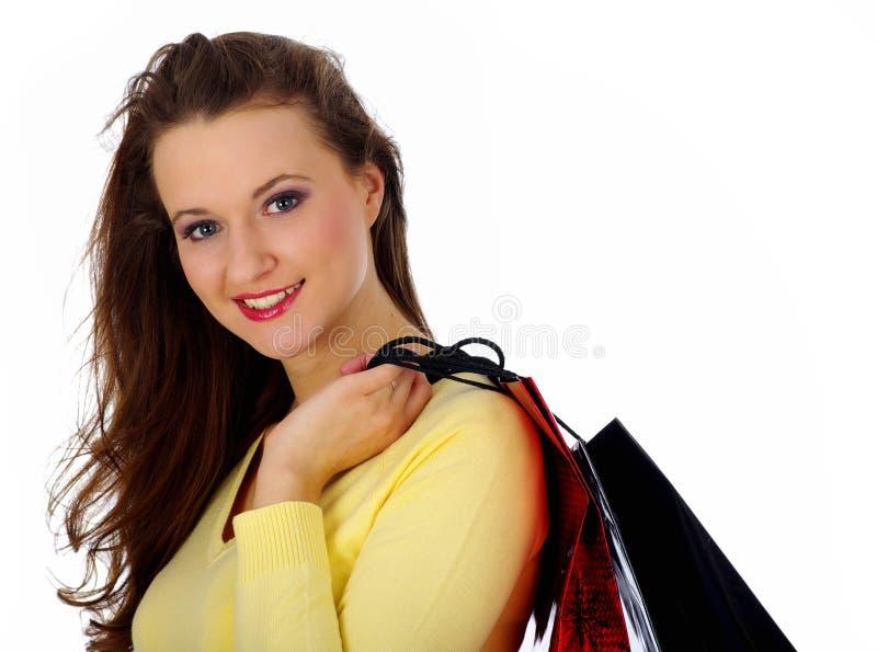Mulher bonita de compra sobre o fundo branco imagens de stock
