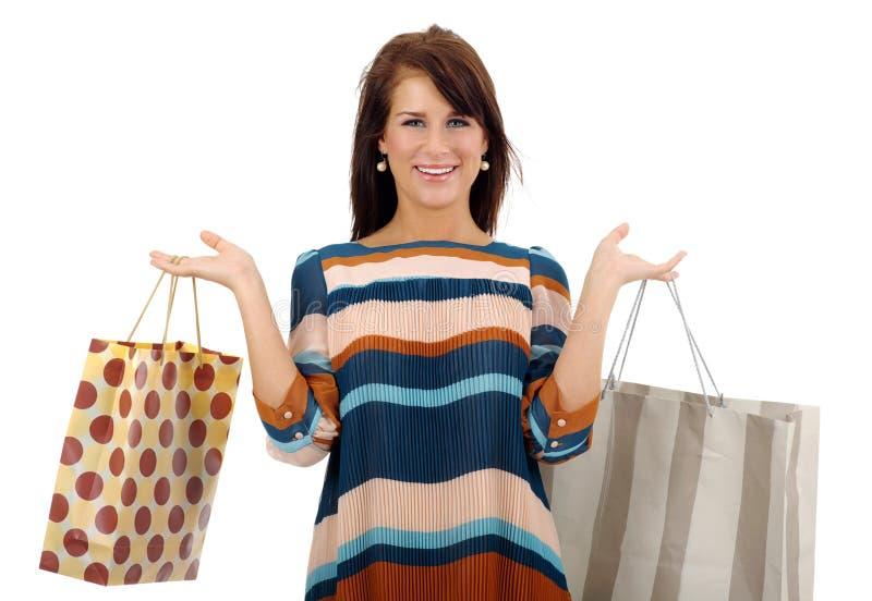 Mulher bonita de compra sobre o fundo branco foto de stock