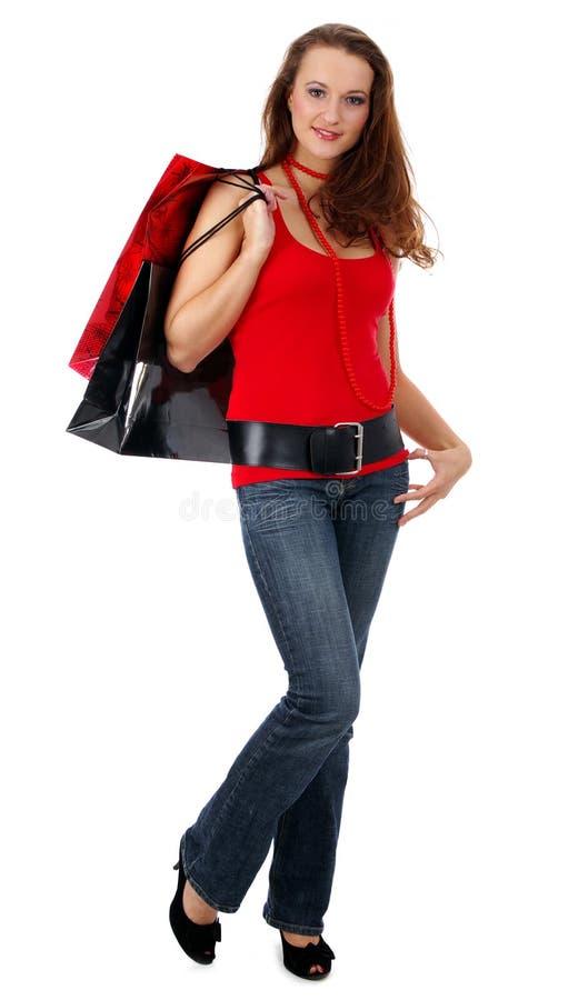 Mulher bonita de compra sobre o fundo branco fotografia de stock royalty free