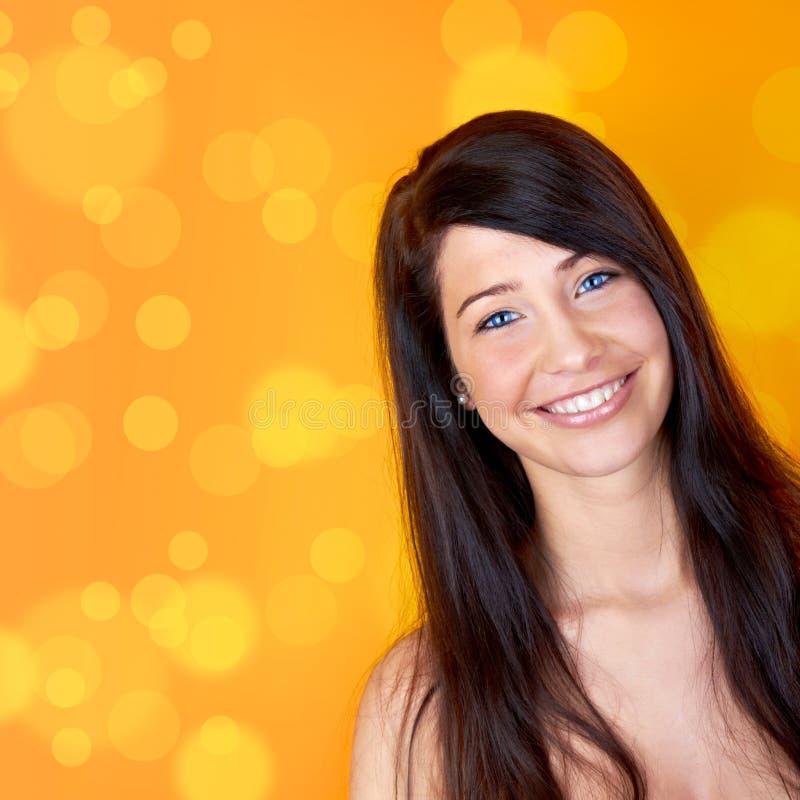 Mulher bonita de sorriso fotografia de stock