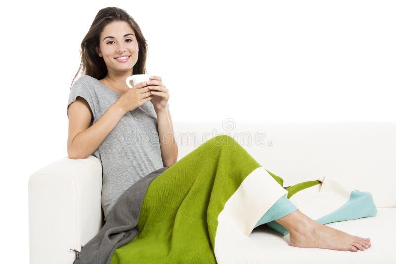 Download Chá bebendo no sofá foto de stock. Imagem de encantador - 29846422