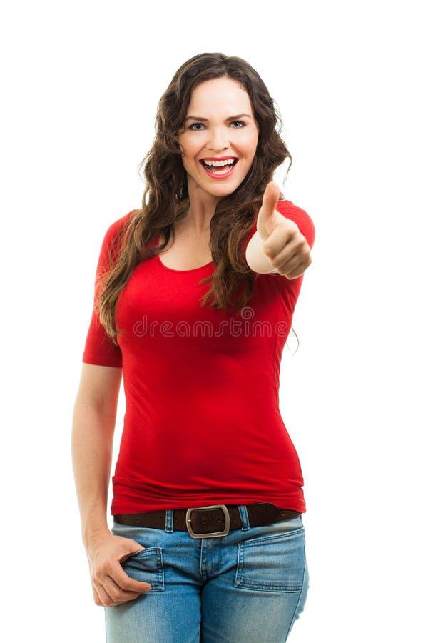 Mulher bonita feliz que dá thums acima fotografia de stock