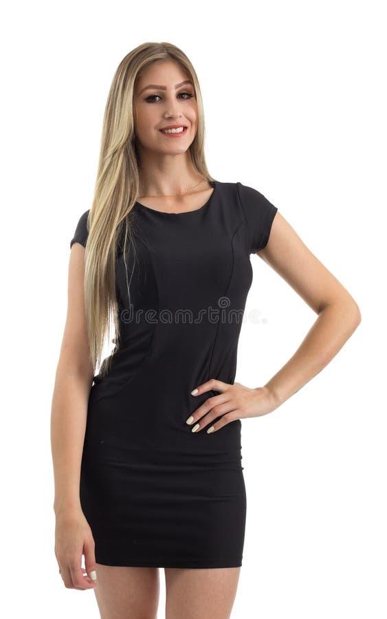 Mulher bonita A mão que descansa na pessoa loura da cintura está vestindo foto de stock royalty free