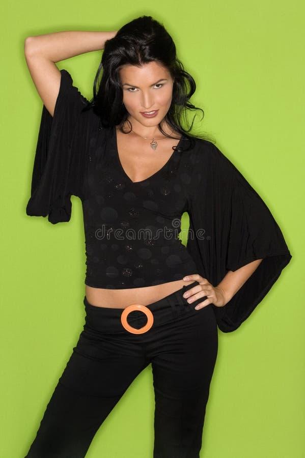 Mulher bonita no preto fotografia de stock
