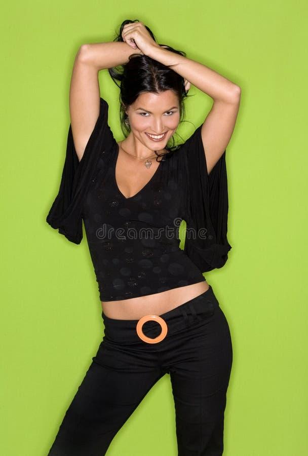 Mulher bonita no preto imagem de stock royalty free