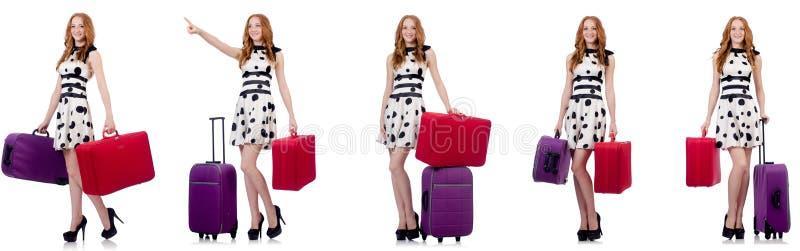 A mulher bonita no vestido do ?s bolinhas com as malas de viagem isoladas no branco imagem de stock royalty free