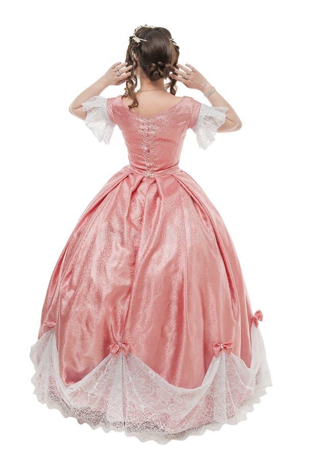 Mulher bonita no vestido medieval hist?rico velho isolado Pose traseira foto de stock
