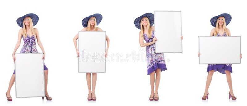 A mulher bonita no vestido roxo com whiteboard foto de stock royalty free