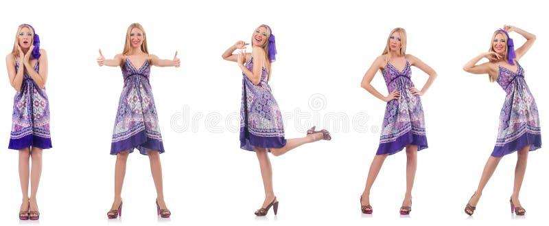 A mulher bonita no vestido roxo isolado no branco imagem de stock