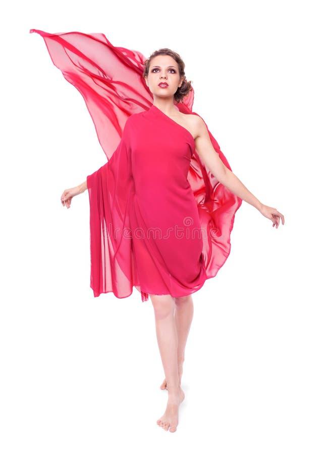 Mulher bonita no vestido vermelho do vôo imagens de stock