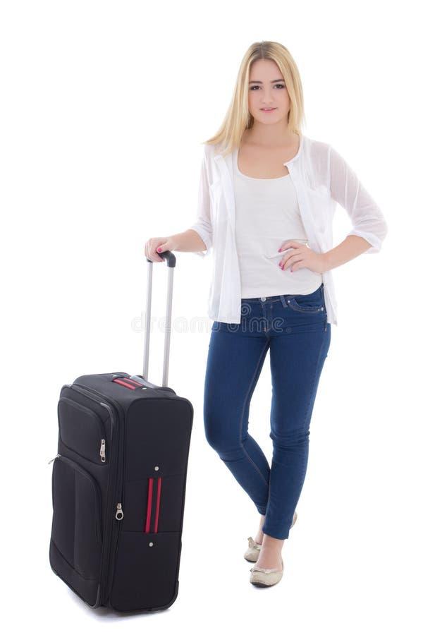 Mulher bonita nova com a mala de viagem isolada no branco fotografia de stock
