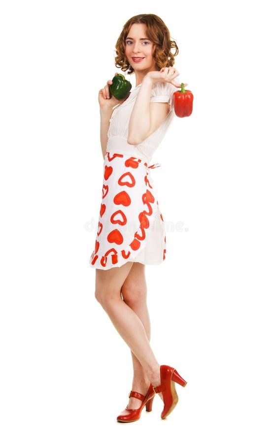 Mulher bonita nova com paprika frescas fotos de stock royalty free