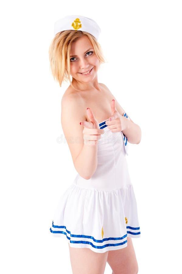 Mulher bonita nova do marinheiro que aponta para a frente fotos de stock