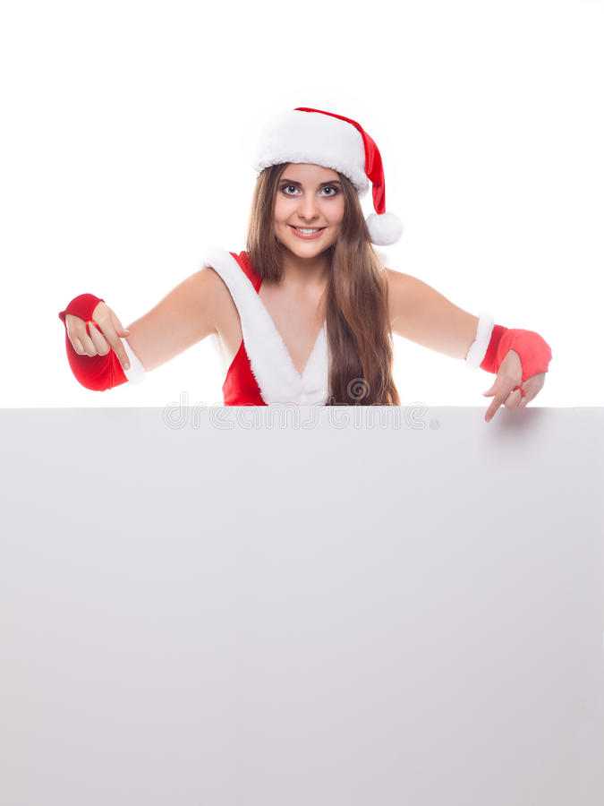 Mulher bonita nova do Natal no chapéu de Santa que guarda a placa vazia imagens de stock