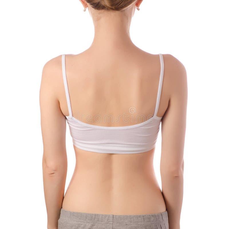 Mulher bonita nova na beleza branca da saúde da parte traseira da fêmea do sutiã da parte superior do t-shirt fotos de stock