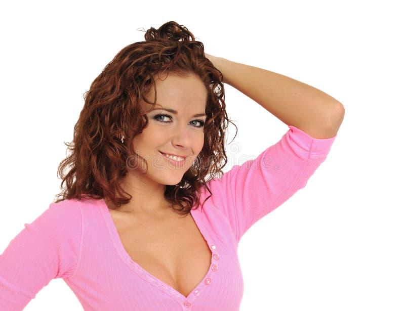 Mulher bonita nova na cor-de-rosa - imagem de stock