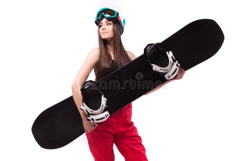Mulher bonita nova no snowboard curto preto da posse da camiseta de alças imagem de stock