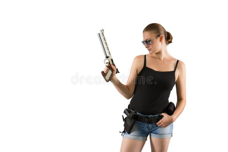 Mulher bonita nova que guarda uma arma do esporte no fundo branco fotografia de stock royalty free